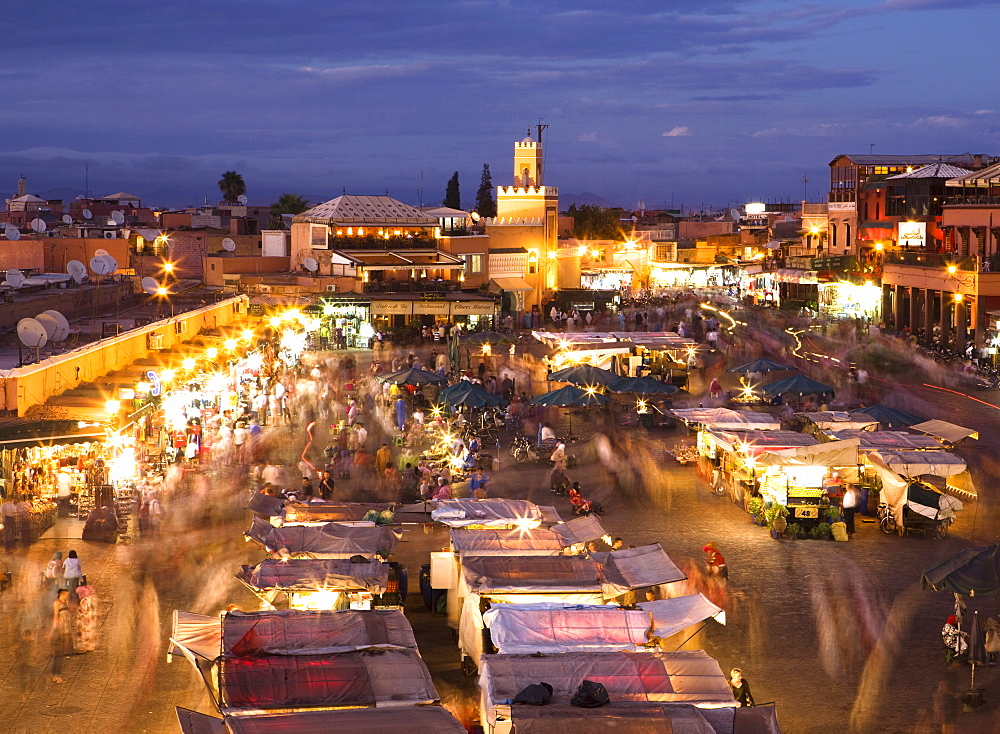 View over Djemaa el Fna at dusk with foodstalls and crowds of people, Marrakech, Morocco, North Africa, Africa - 321-4739