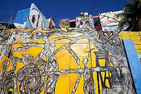 Buildings painted in colourful Afro-Cuban art, masterminded by artist Salvador Gonzalez Escalona, Callejon de Hamel, Havana, Cuba, West Indies, Central America