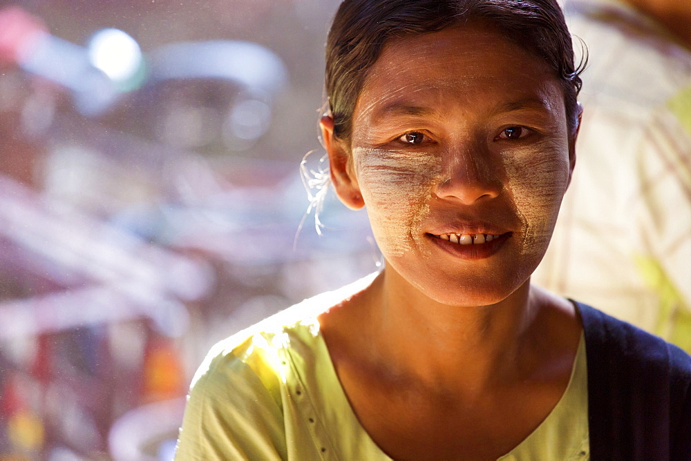 Local woman with Thanakha traditional face painting, Thiri Mingalar Market, Yangon (Rangoon), Myanmar (Burma), Asia
