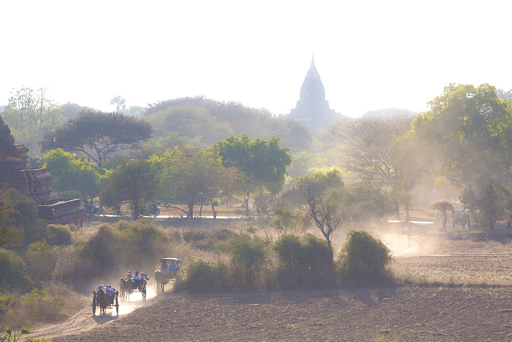 View over the temples of Bagan swathed in early morning mist, from Shwesandaw Paya, Bagan, Myanmar (Burma), Southeast Asia