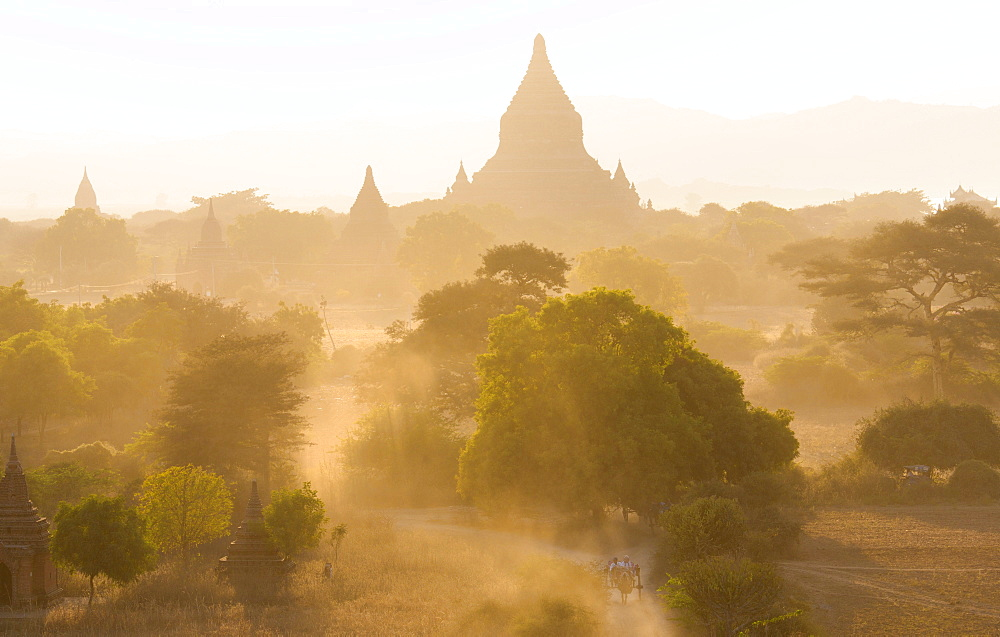 View over the temples of Bagan swathed in dust and evening sunlight, from Shwesandaw Paya, Bagan, Myanmar (Burma), Southeast Asia