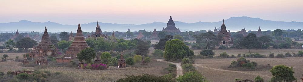 Panoramic view at dusk over the plain and temples of Bagan from Shwesandaw Paya, Bagan Central Plain, Myanmar (Burma)