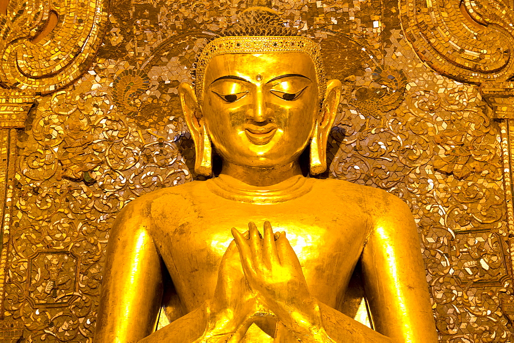 Golden Buddha image standing 33ft tall inside Ananda Paya, Bagan, Myanmar (Burma), Southeast Asia