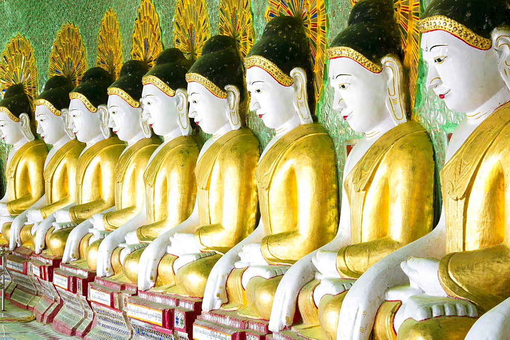 Some of the 45 Buddha images found at a crescent-shaped colonnade at Umin Thounzeh on Sagaing Hill, near Mandalay, Myanmar (Burma), Asia  - 321-5090