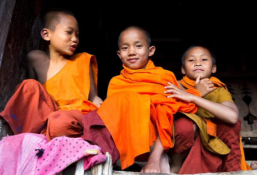 Three novice monks in village near Kengtung (Kyaingtong), Shan State, Myanmar (Burma), Asia