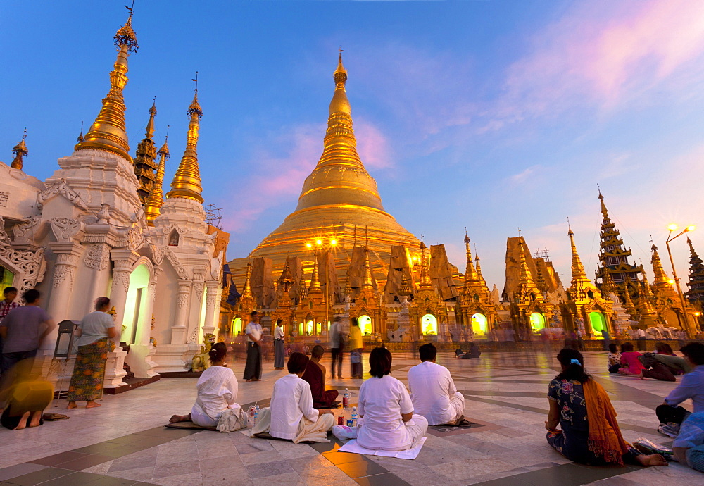 Shwedagon Paya (Pagoda) at dusk with Buddhist worshippers praying, Yangon (Rangoon), Myanmar (Burma), Asia - 321-5180