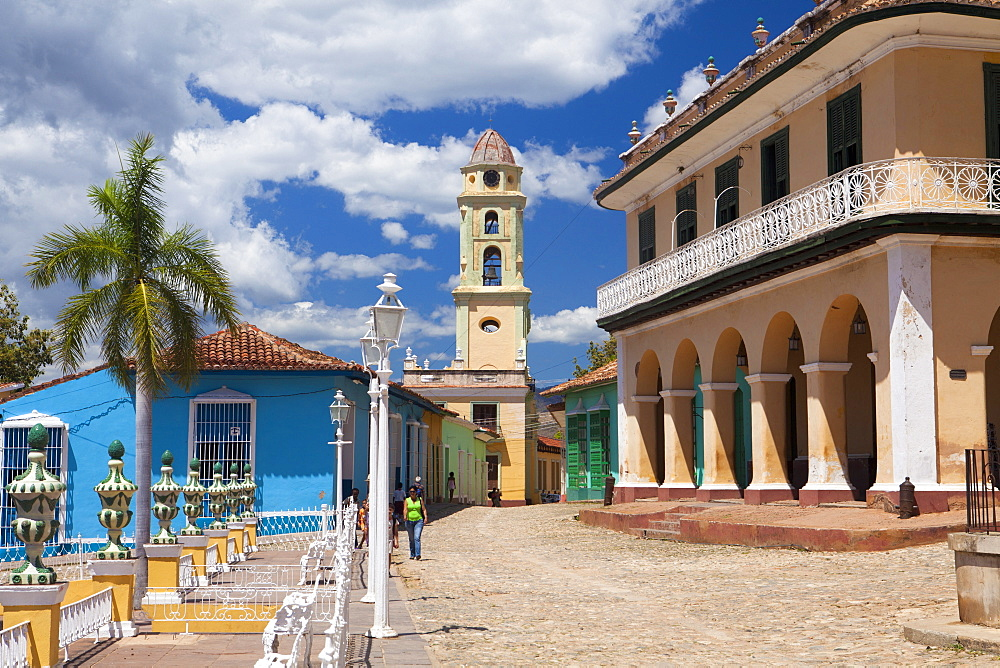 View across Plaza Mayor towards Museo Romantico and the belltower of The Convento de San Francisco de Asis, Trinidad, UNESCO World Heritage Site, Cuba, West Indies, Central America