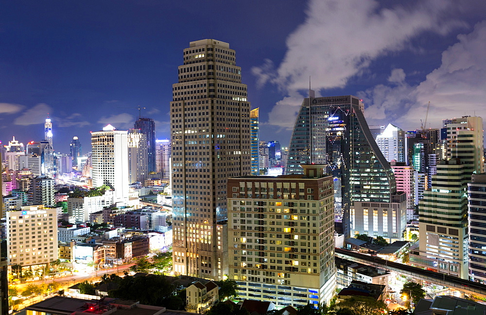 High rise buildings of Bangkok at night from Rembrandt Hotel and Towers, Sukhumvit 18, Bangkok, Thailand, Southeast Asia, Asia