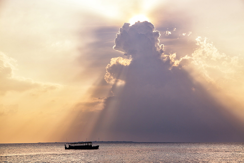Dramatic cloud formations and boat in silhoutte at sunset, Dhuni Kolhu, Baa Atoll, Republic of Maldives, Indian Ocean, Asia