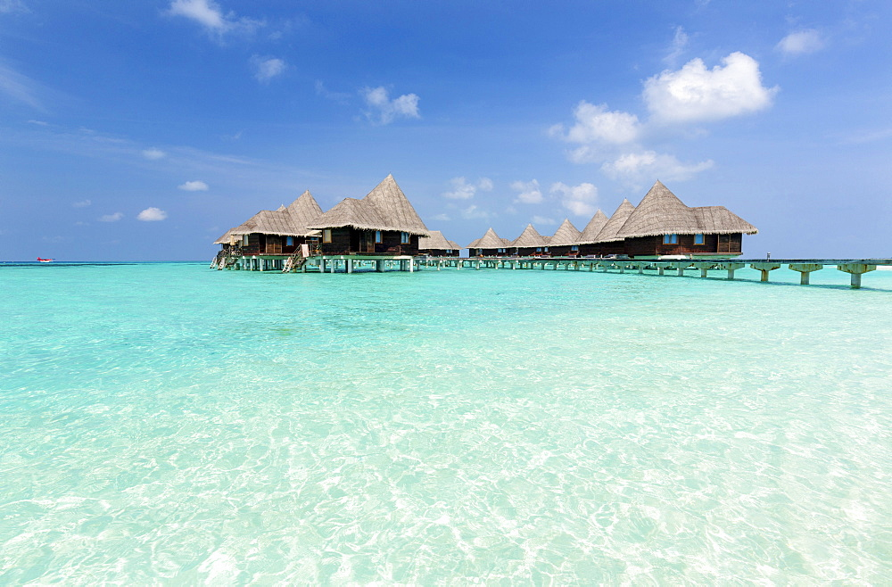 Clear sea, blue sky and over-water villas, Coco Palm Resort, Dhuni Kolhu, Baa Atoll, Republic of Maldives, Indian Ocean, Asia