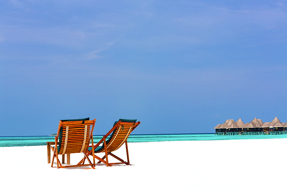 Wooden sun loungers on beach, Coco Palm, Dhuni Kolhu, Baa Atoll, Republic of Maldives, Indian Ocean, Asia