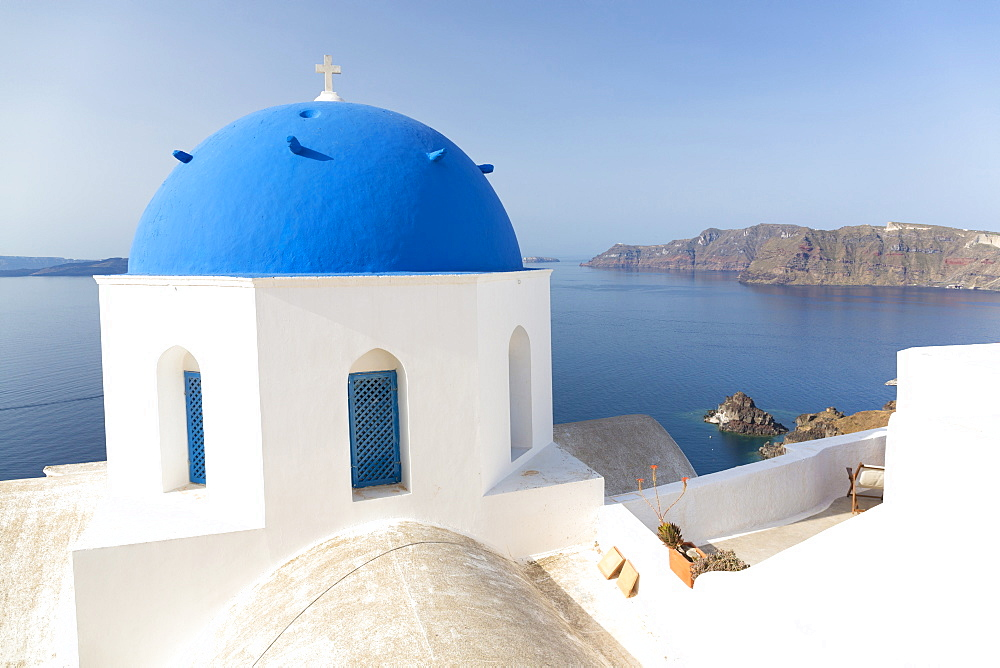 White church with blue dome overlooking the Caldera, Oia, Santorini, Cyclades, Greek Islands, Greece, Europe