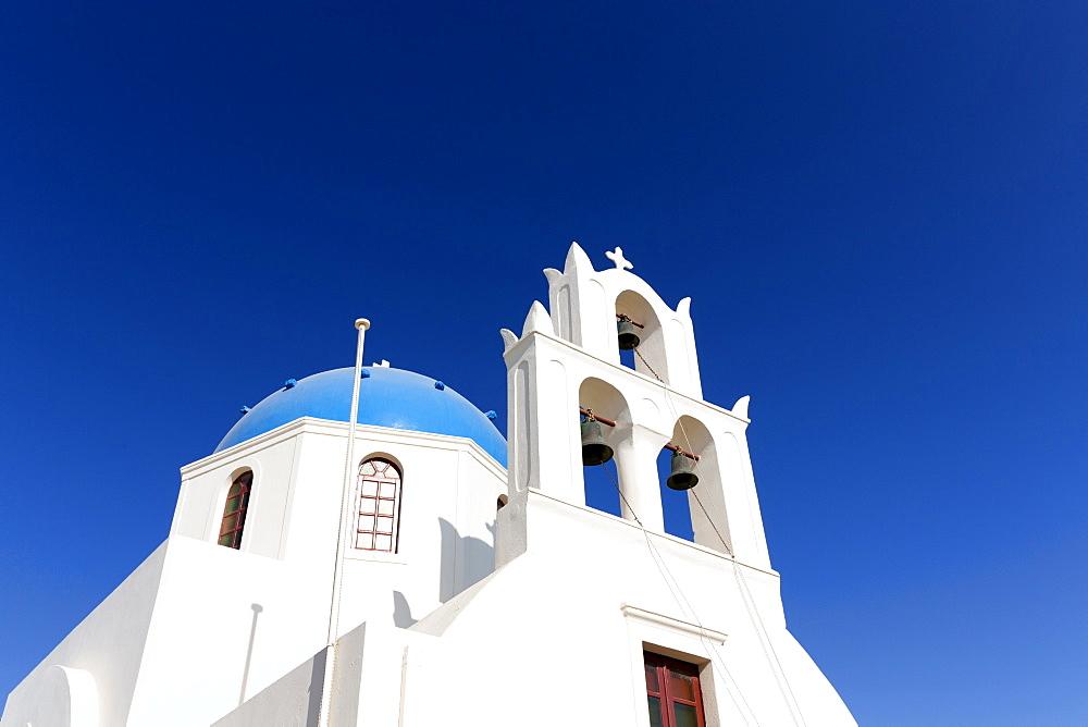 Classic Greek Orthodox church with blue dome, Oia, Santorini, Cyclades, Greece