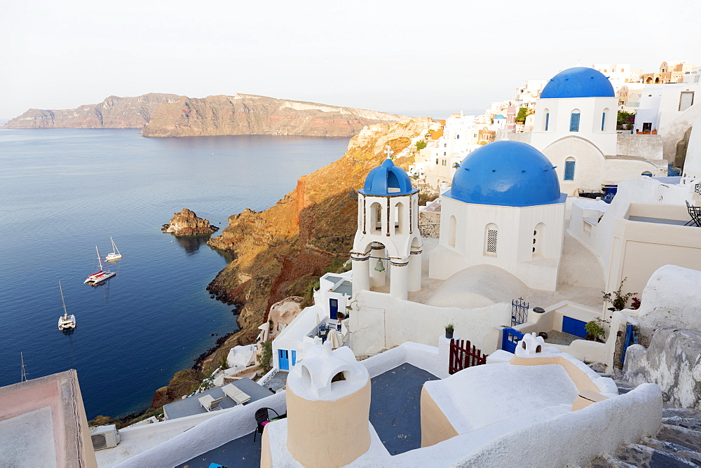 Classic view of the village of Oia with its blue domed churches and colourful houses, Oia, Santorini, Cyclades, Greek Islands, Greece, Europe - 321-5634