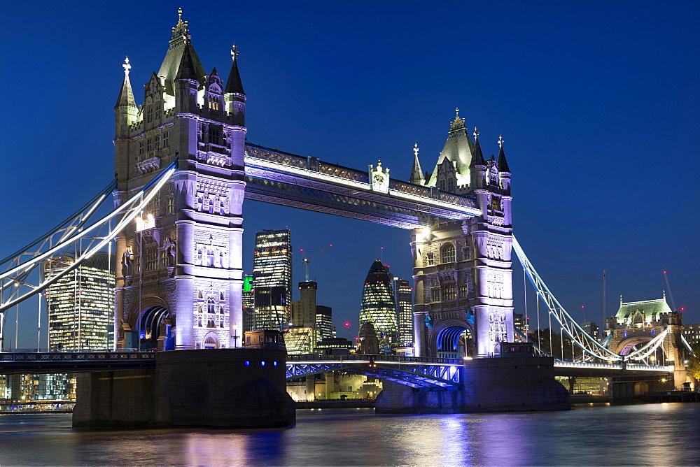 Towwer Bridge illuminated at night, London, England