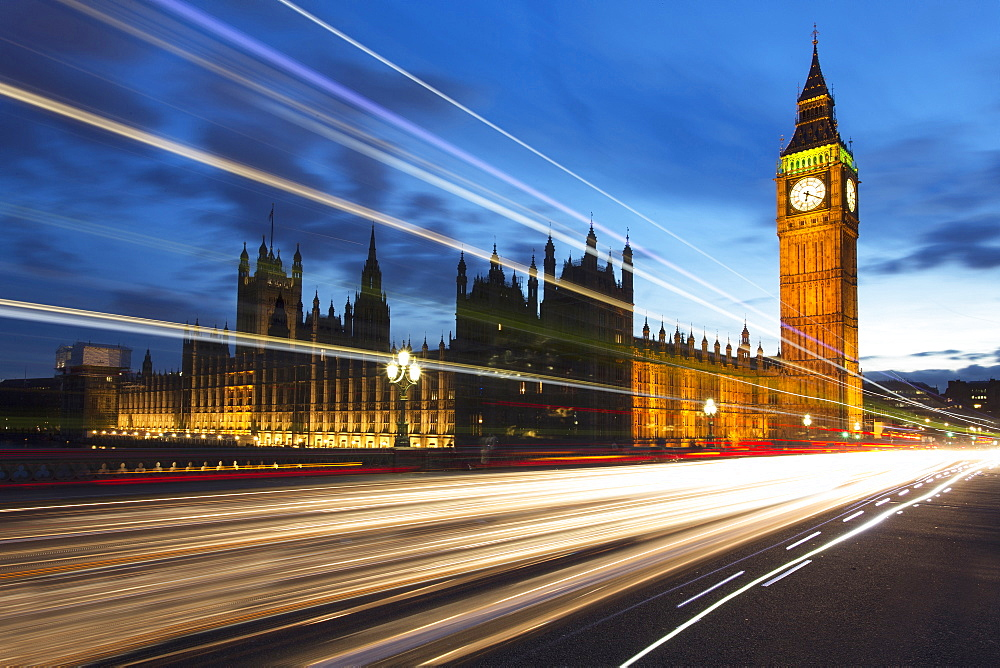 Big Ben and The Houses of Parliament at night with traffic trails on Westminster Bridge, London, England, United Kingdom, Europe - 321-5662