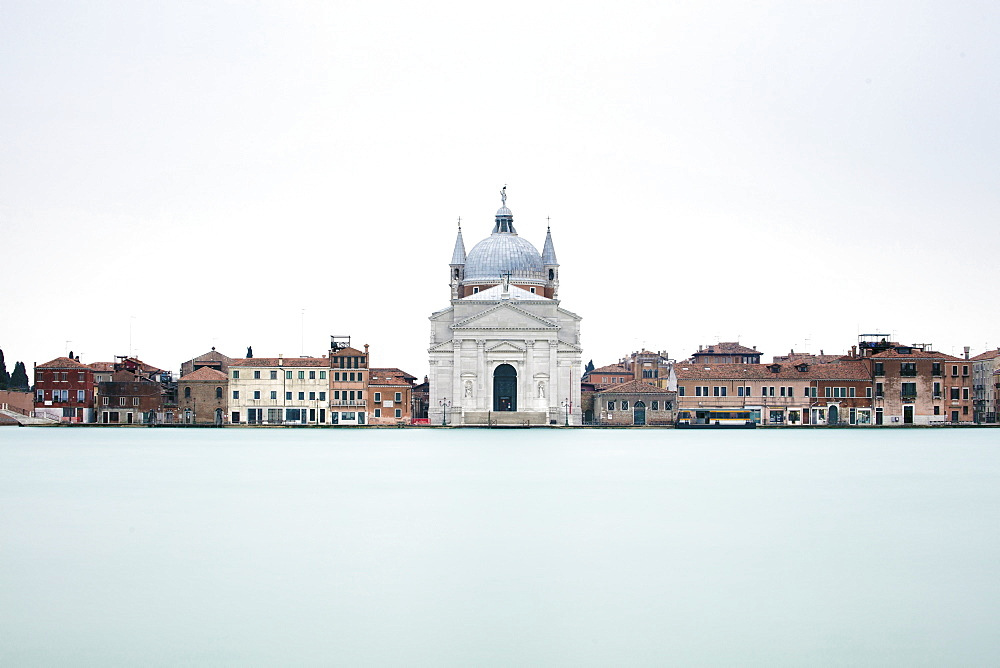 Long exposure image looking across Canale Della Giudecca towards Chiesa del Santissimo Redentore Giudecca, Venice, UNESCO World Heritage Site, Veneto, Italy, Europe