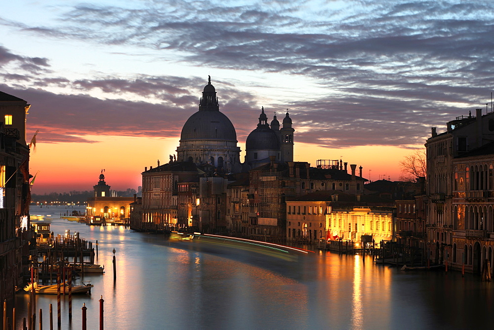 View along Grand Canal towards Santa Maria Della Salute from Accademia Bridge at dawn, Venice, UNESCO World Heritage Site, Veneto, Italy, Europe