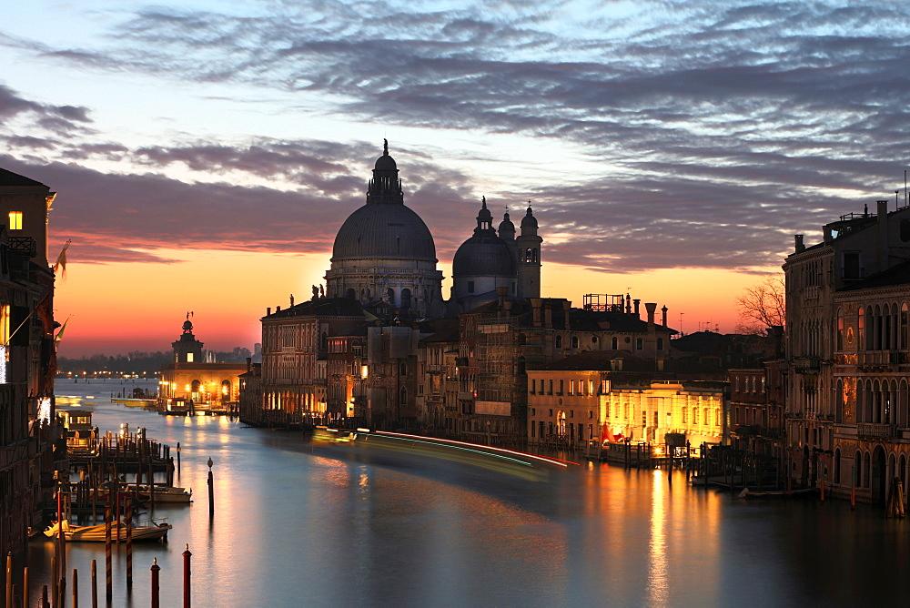 View along Grand Canal towards Santa Maria Della Salute from Accademia Bridge at dawn, Venice, Italy
