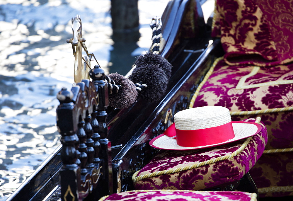 Detail of traditional Venetian Gondola showing Gondolier's straw hat, Venice, Veneto, Italy, Europe