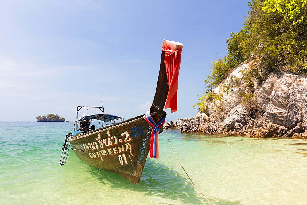 Longtail boat and limestone cliffs, Koh Pakbia, Koh Hong Islands, Ao Nang, Krabi, Thailand