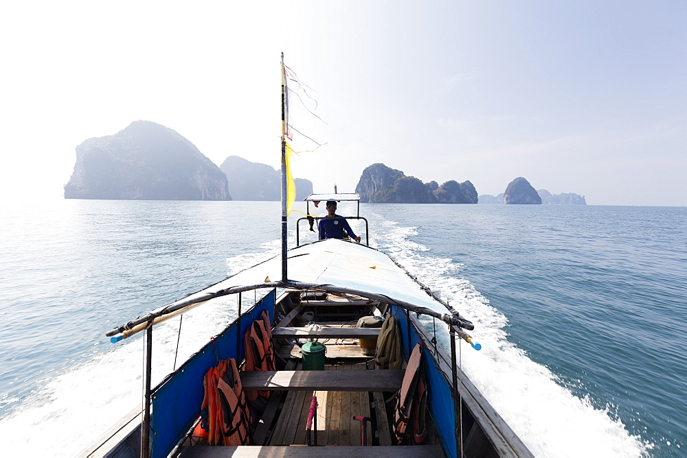 Traditional longtail boat with the Koh Hong Islands in the background, Krabi Coast, Krabi, Thailand