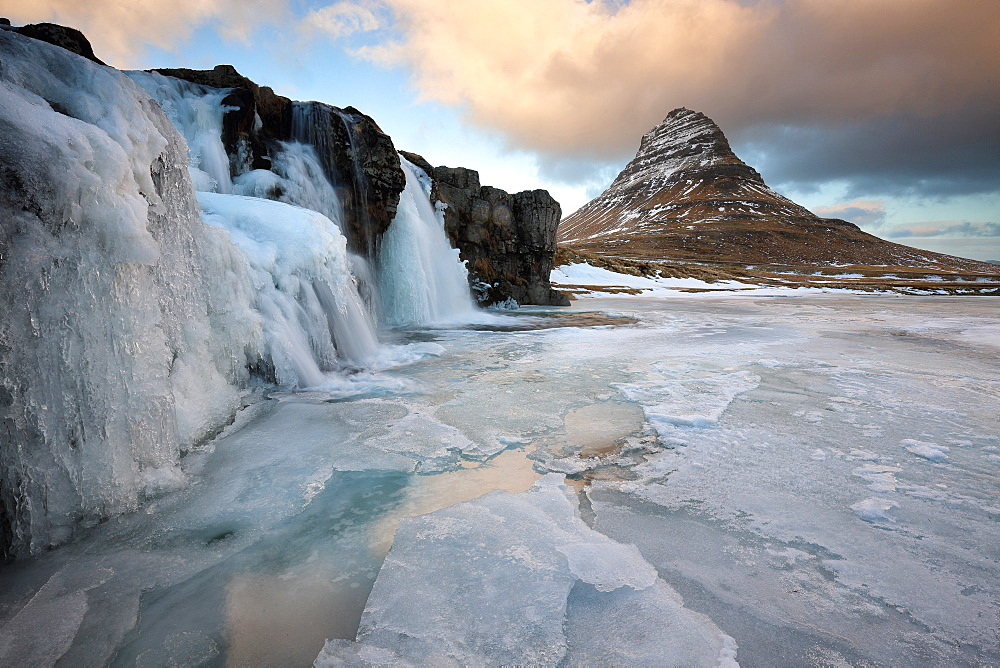 Kirkjufell (Church Mountain) in winter, with frozen waterfall, near Grundafjordur, Snaefellsnes Peninsula, Iceland, Polar Regions