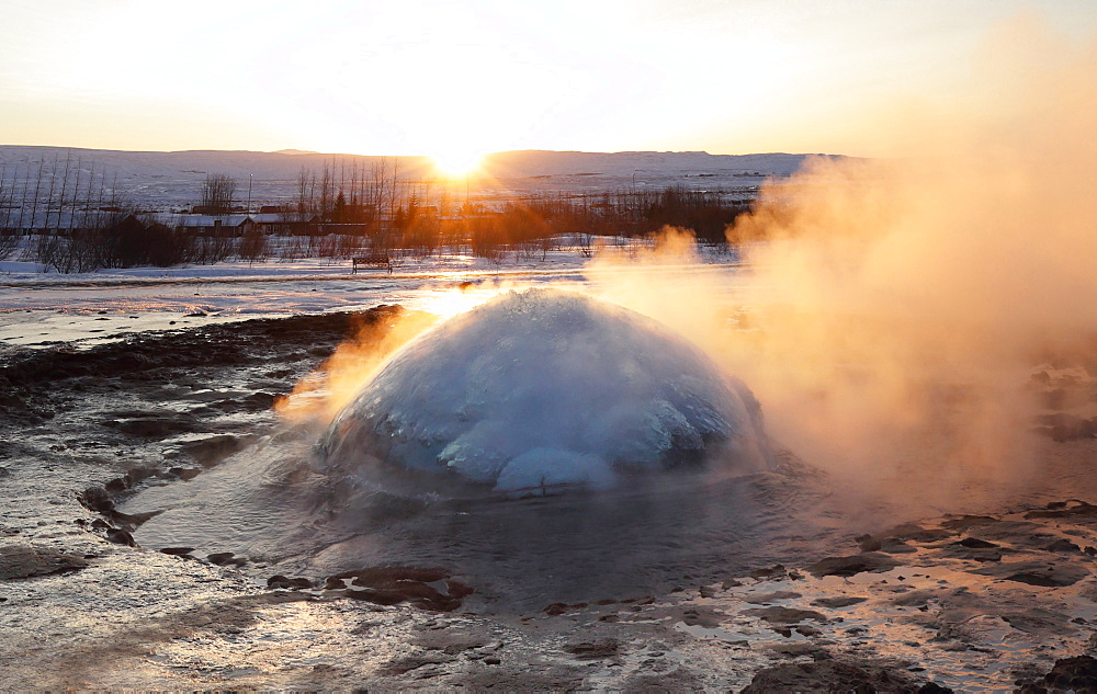 Strokkur Geysir erupting at sunrise during winter, geothermal area beside the Hvita River, Geysir, Iceland, Polar Regions