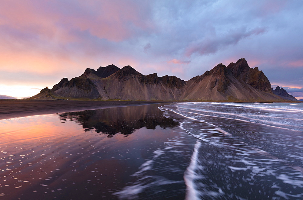 View of the mountains of Vestrahorn from black volcanic sand beach at sunset, Stokksnes, South Iceland, Polar Regions