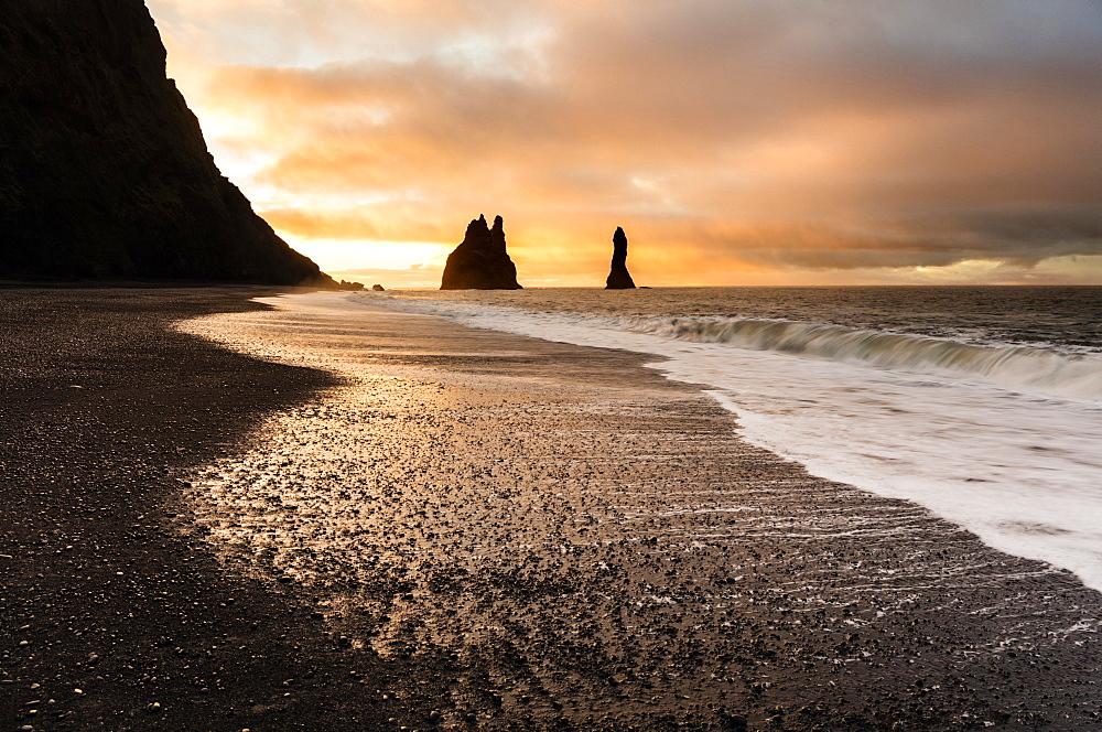Rock stacks of Reynisdrangar at sunrise, from Halsanefs Hellir Beach near Vik, South Iceland, Polar Regions - 321-5802