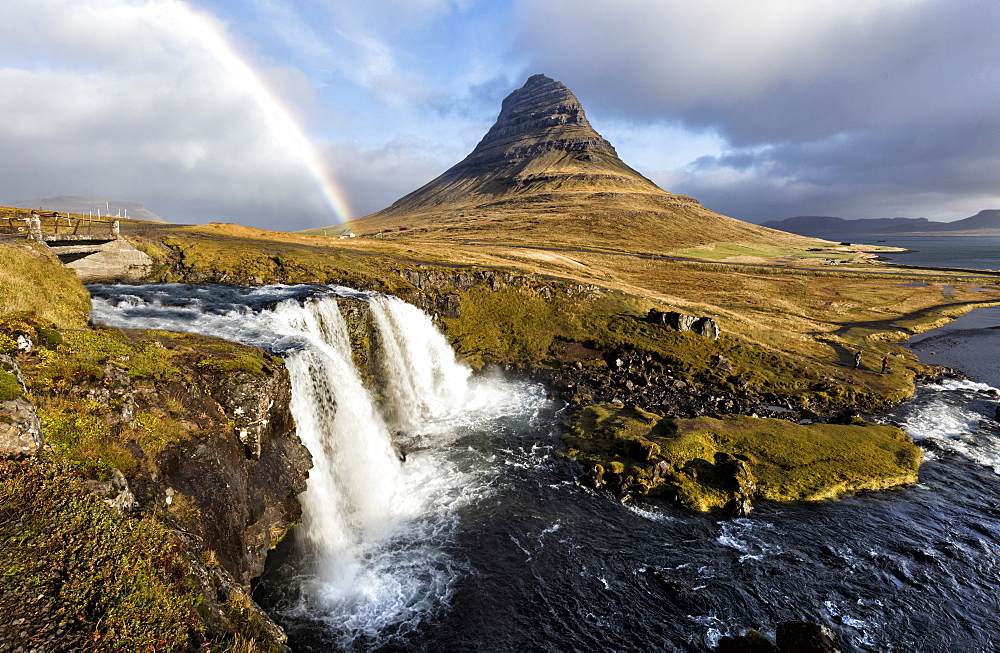 View of Kirkjufell (Church Mountain), mountain stream and rainbow, Grundafjordur, Snaefellsnes Peninsula, Iceland, Polar Regions