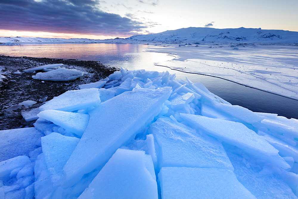 Sunset over frozen Jokulsarlon Glacial Lagoon in winter, South Iceland, Polar Regions