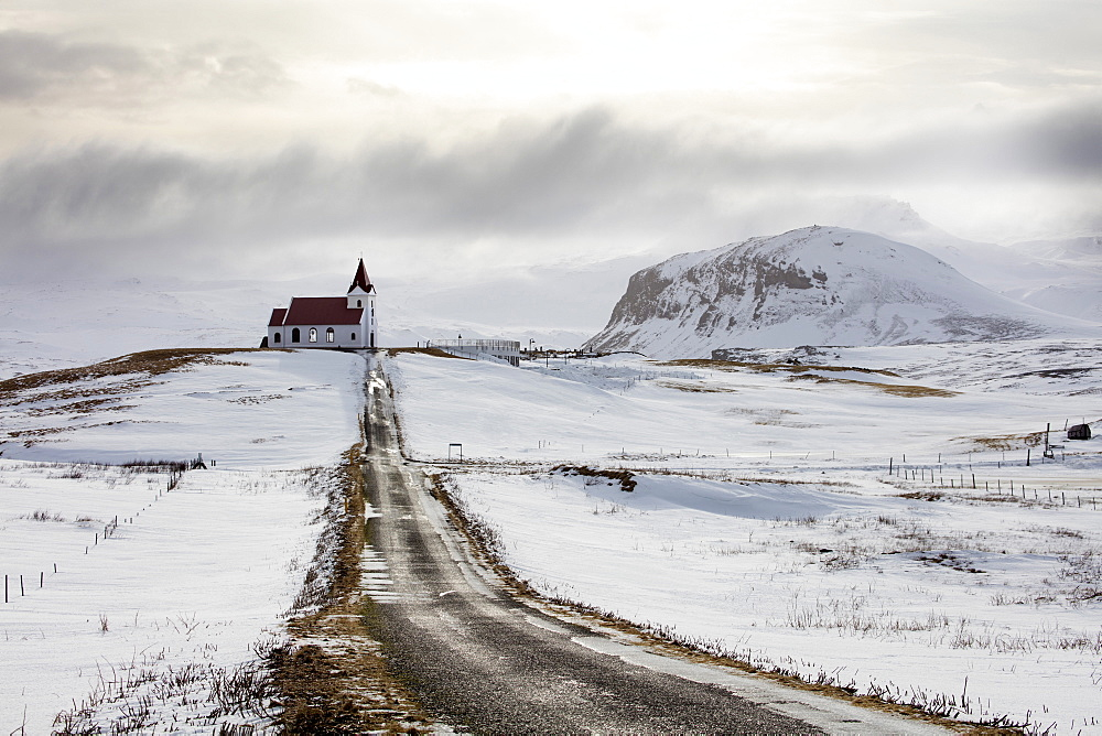 Isolated church (Ingjaldscholskirkja) in winter near Rif on the Snaefellsnes Peninsula, Iceland, Polar Regions