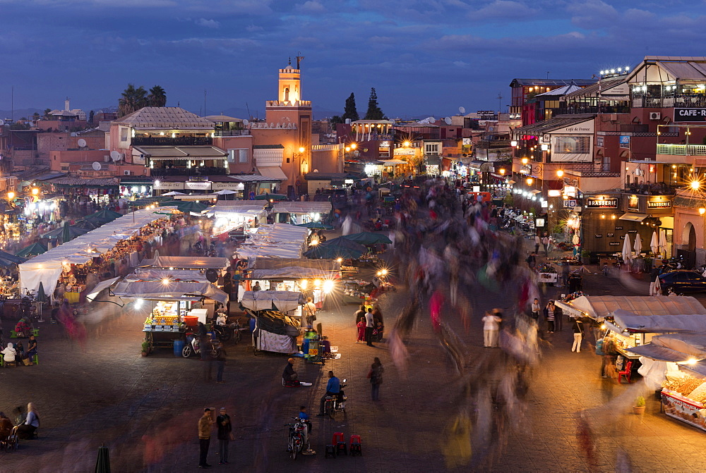 View over the Djemaa el Fna at dusk showing food stalls and crowds of people, Marrakech, Morocco, North Africa, Africa - 321-5835