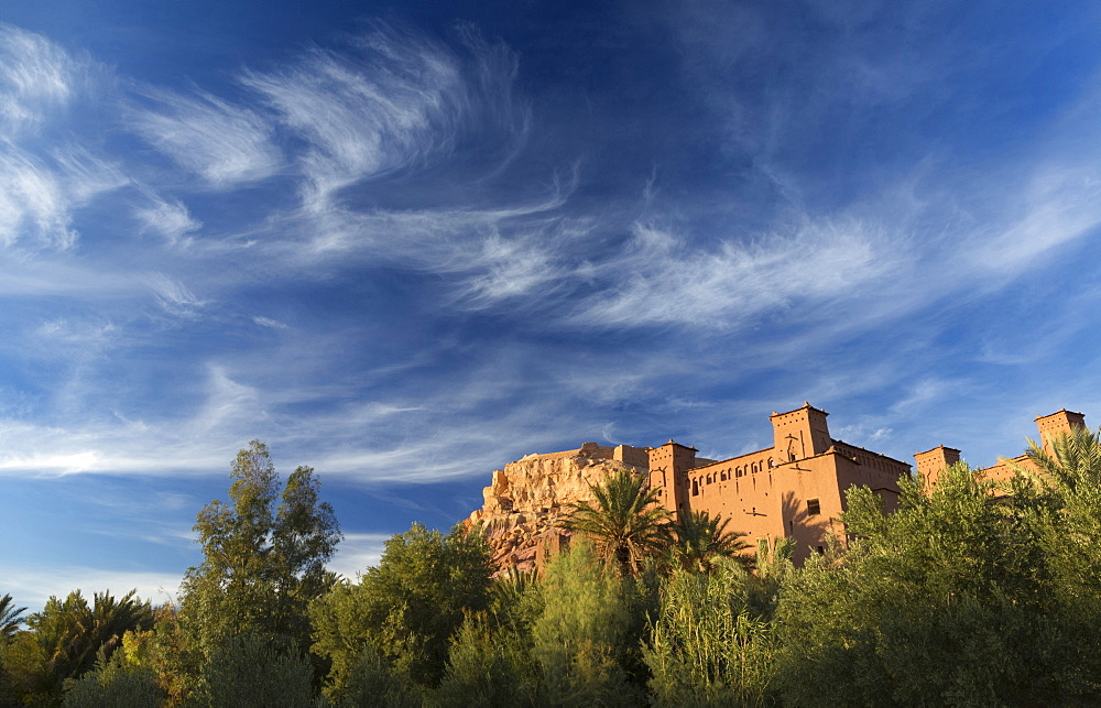 The ancient mud brick buildings of Kasbah Ait Benhaddou bathed in evening light, UNESCO World Heritage Site, near Ouarzazate, Morocco, North Africa, Africa