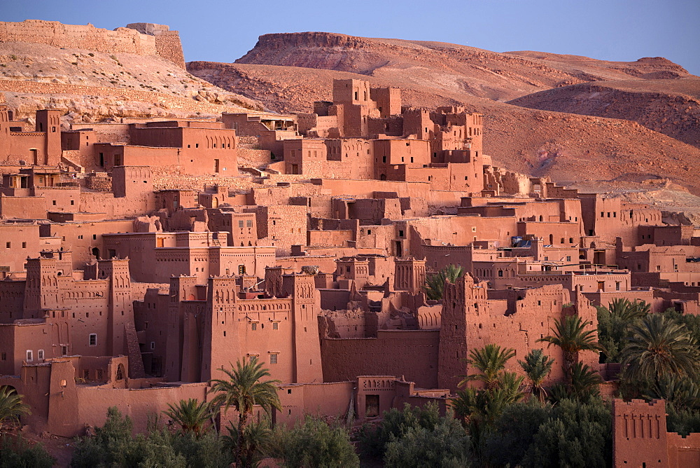 The ancient mud brick buildings of Kasbah Ait Benhaddou bathed in golden morning light, UNESCO World Heritage Site, near Ouarzazate, Morocco, North Africa, Africa