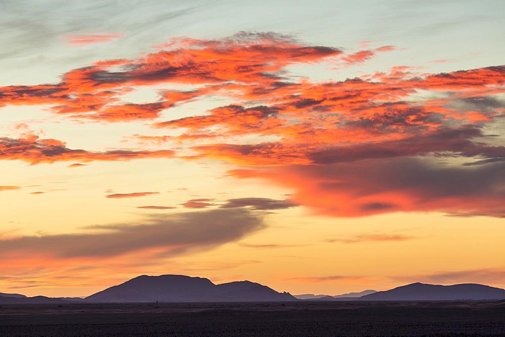 Dramatic sunset over mountains near Merzouga, Morocco