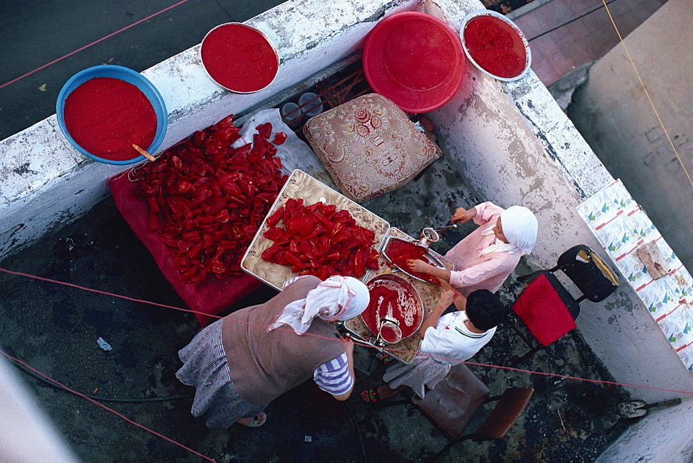 Women making red pepper sauce, old city area, Istanbul, Turkey, Europe - 341-1123