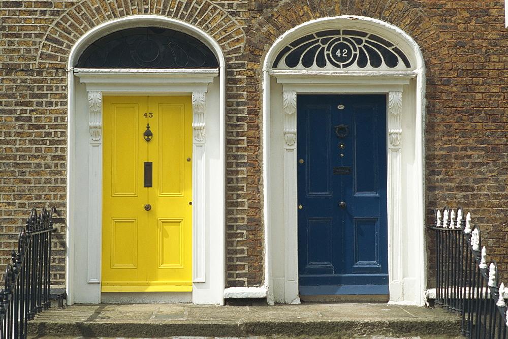 Two doorways with painted doors on Bride Street in Dublin, Eire, Europe