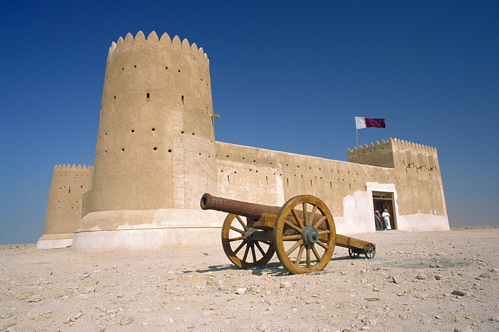 The Al Zu Barah Fort, restored and now open as a museum, with a cannon in the foreground, Qatar, Middle East