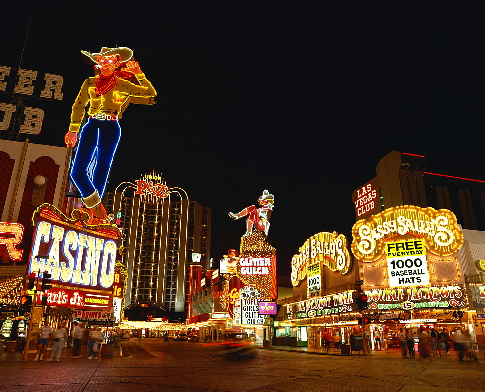 Neon signs at night on a street in Las Vegas, Nevada, United States of America, North America