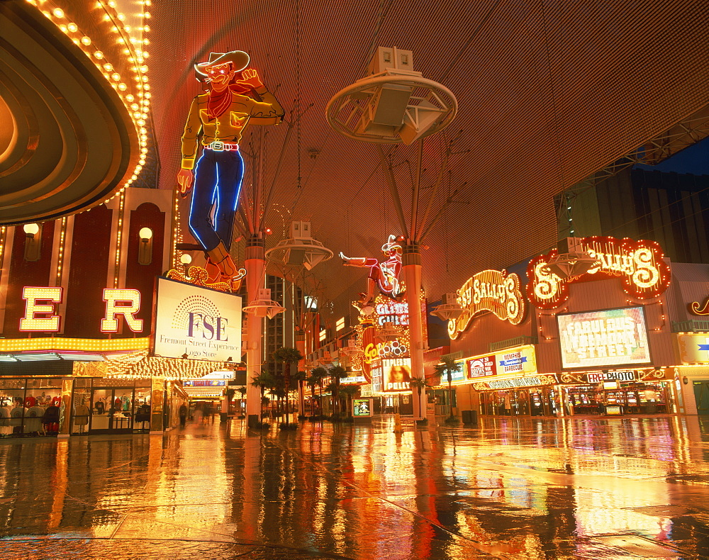 Reflections of neon lights and signs along Fremont Street in Las Vegas, Nevada, United States of America, North America