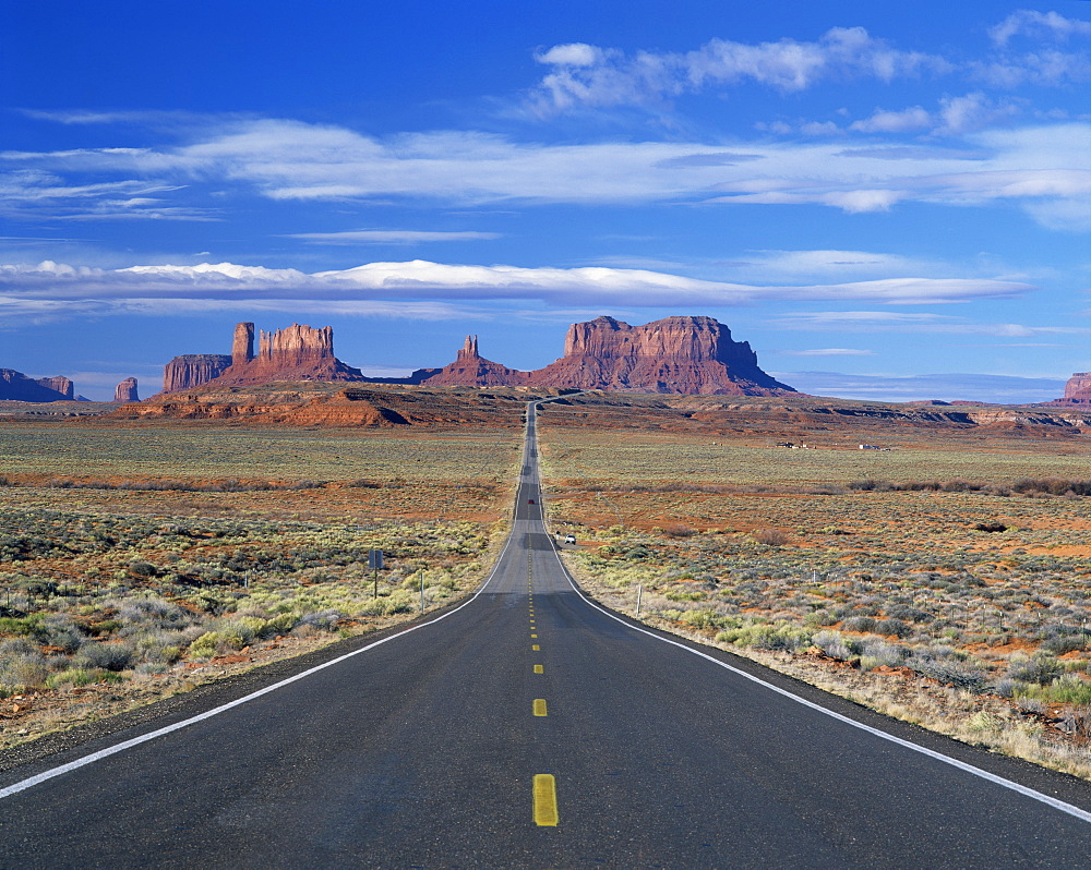Straight road heading for Monument Valley, Navajo Reserve, on border of Arizona and Utah, United States of America, North America