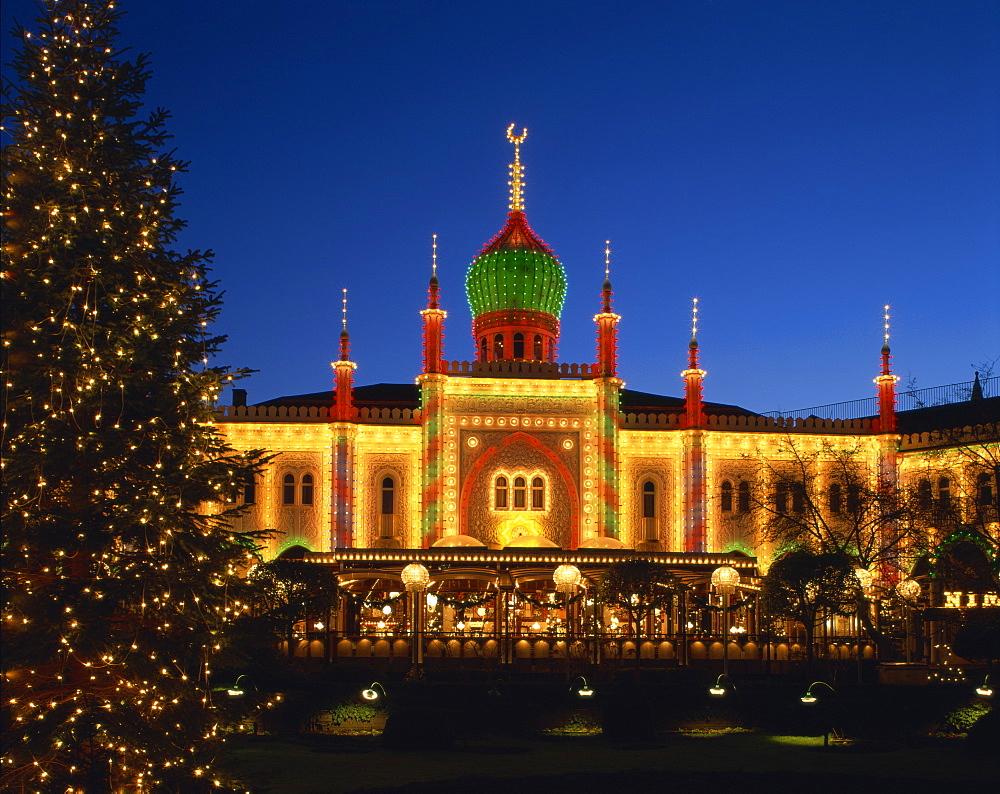 Illuminated Christmas tree and the Pavilion at dusk, Tivoli Gardens, Copenhagen, Denmark, Scandinavia, Europe