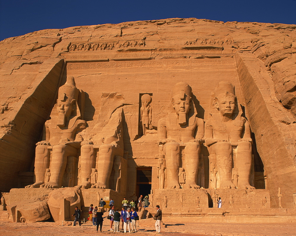 Tourists in front of the Temple of Re-Herakhte, built for Ramses II, also known as the Sun or Great Temple of Ramses II, Abu Simbel, UNESCO World Heritage Site, Nubia, Egypt, North Africa, Africa