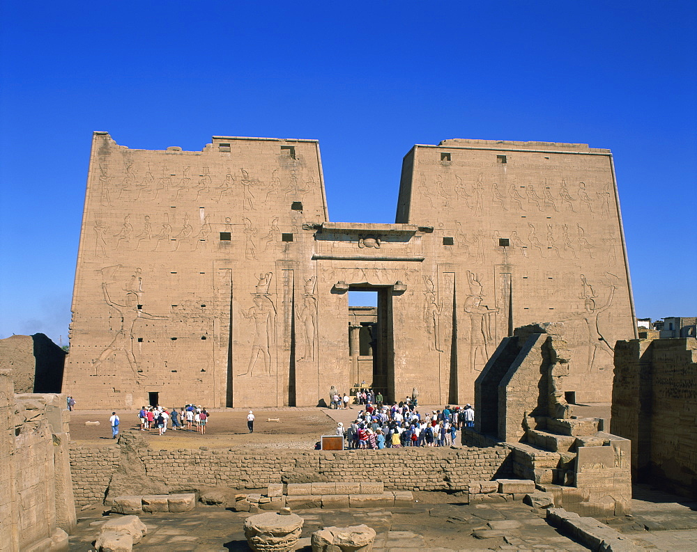 Crowds of tourists in front of the entrance pylon of the temple at Edfu, Egypt, North Africa, Africa