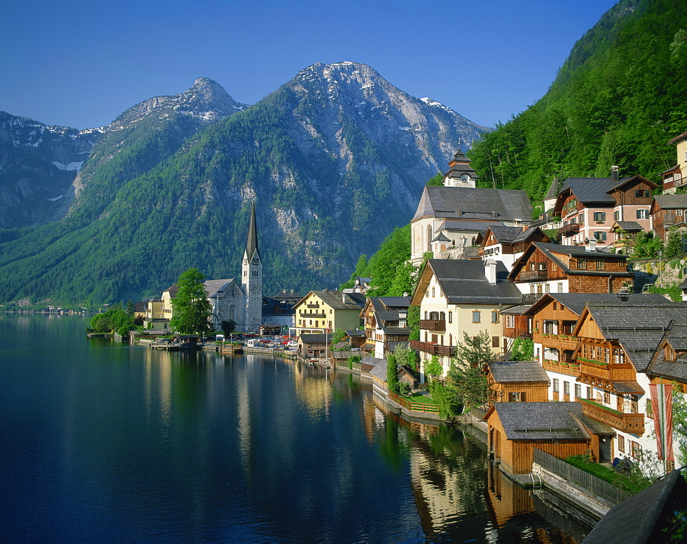Houses, chalets and the church of the village of Hallstatt beside the lake, in morning light, UNESCO World Heritage Site, near Salzburg in the Salzkammergut, Austria, Europe