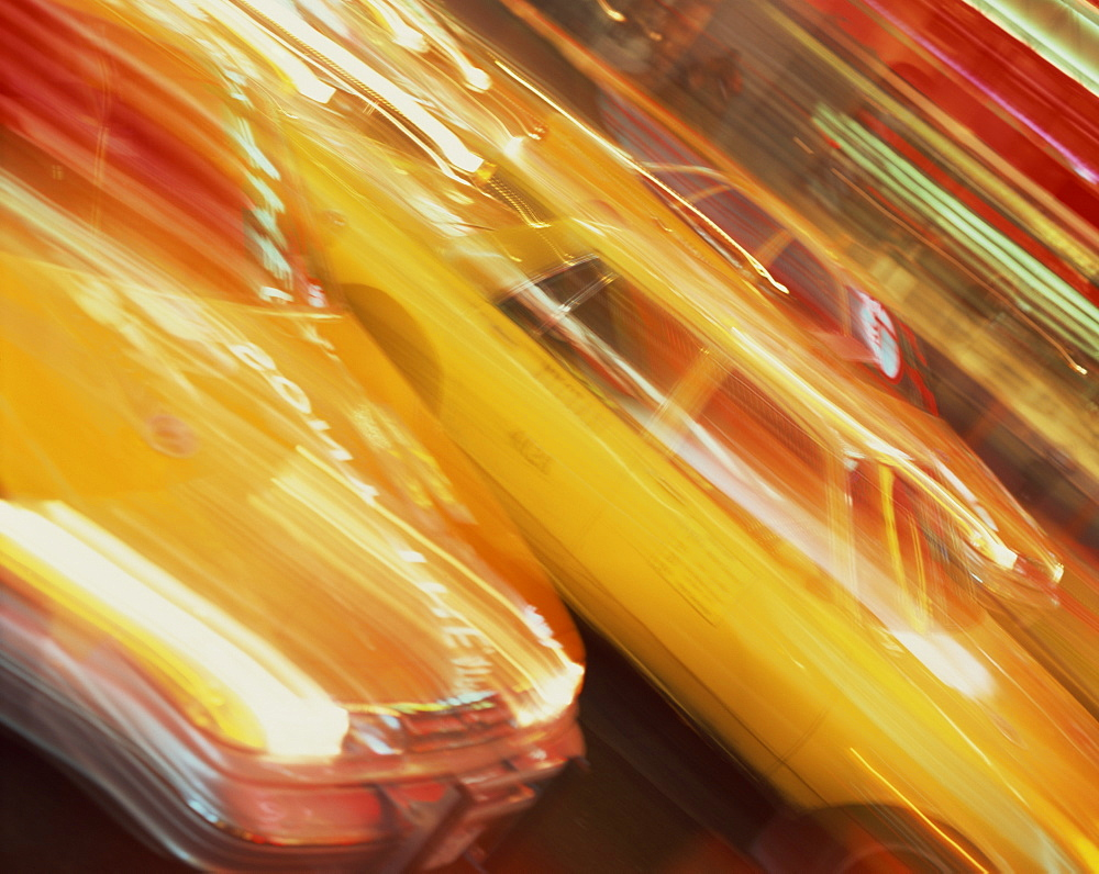 Blurred yellow cabs, New York, United States of America, North America