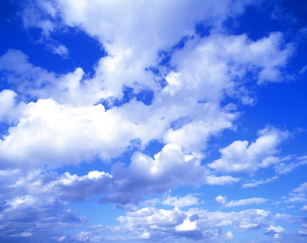 Cloudscape of puffy white clouds in a blue sky