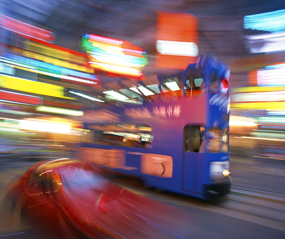 Tram in blurred motion at dusk, Causeway Bay, Hong Kong, China, Asia